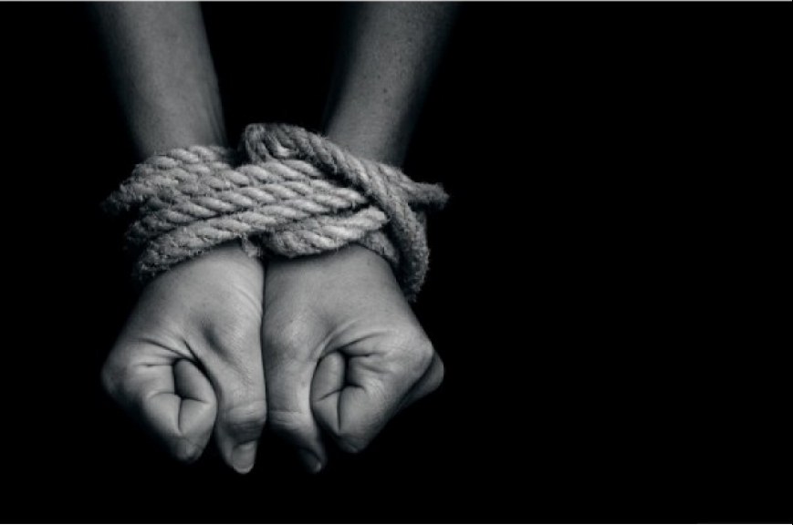 A close up of someones hands being tied up by rope.